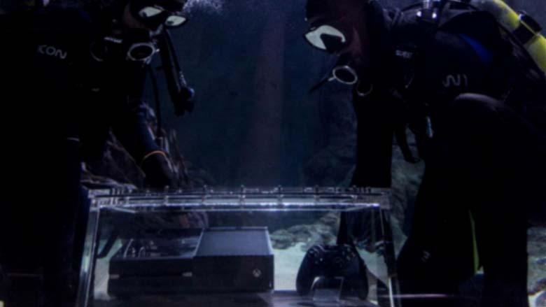 Xbox One submerged in a shark tank