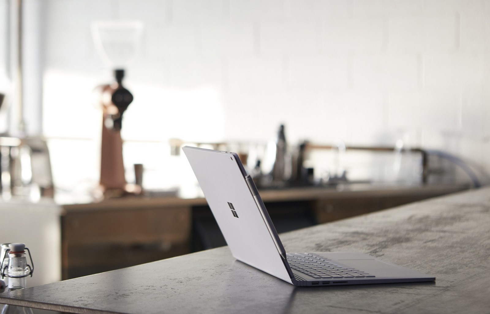 Surface Book 2 on table with background